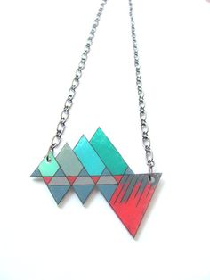 """Charms Number Nineteen: geometric shrink plastic necklace """"mountain reflection"""" in turquoise gray and pink Shrink Paper, Shrink Plastic Jewelry, Shrink Art, Shrink Film, Diy Jewelry, Jewelry Making, Jewellery, Plastic Design, Shrinky Dinks"""
