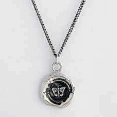 Silver talisman pendant by Pyrrha, features a butterfly, which is a symbol of the soul, rebirth, transformation and metamorphosis.