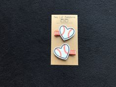 This black and orange stitched heart baseball feltie hair clip is the perfect addition to any girls baseball outfit and is perfect for the SF Giants fan! The feltie comes securely attached to a partially lined 1 3/4 inch single prong alligator clip lined with chevron grosgrain ribbon. This clip can be purchased as a right side clip, left side clip or as a set of two hair clips!  All hair clips are handmade with love by me in my smoke and pet free home. Please convo me if you have any que...