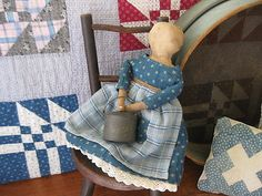wonderful quilts in the background. Great old doll with indigo calico dress and tiny bucket.