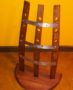 Wine Rack. Made from reclaimed wine barrel. Holds up to 18 bottles. Handmade, stained and sealed oak.