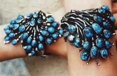 """Frank Patania Sr., c. 1945. Marked """"FP"""" with """"Thunderbird"""",  Sterling silver and Burnham turquoise bracelets."""