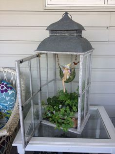 Faerie Garden in a lantern! I already have a black wrought iron stand with 3…