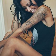 hate that society looks down on people with tattoos that you can see..I think this lady is absolutely beautiful especially with her tattoos! Wish I could do this, but then may not get a job because of judgmental people these days...