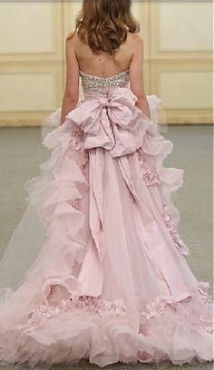 What a gorgeous blush pink gown...love the billowing ruffles and pretty bow, so feminine~❥