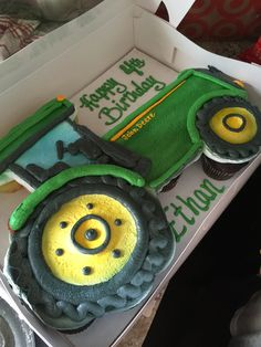 This Tractor Cupcake Cake was made by our local bakery. Our 4 yo absolutely loved his John Deere Cake with cupcakes. Click into the post for more great John Deere Party Ideas!