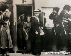 """Empress Alexandra Feodorovna of Russia,Tsarevich Alexei Nikolaevich Romanov of Russia and Tsar Nicholas II of Russia leaving the Imperial Royal Train.  """"AL"""""""