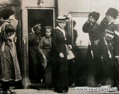 "Empress Alexandra Feodorovna of Russia,Tsarevich Alexei Nikolaevich Romanov of Russia and Tsar Nicholas II of Russia leaving the Imperial Royal Train.  ""AL"""