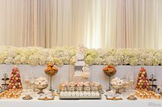 Stunning cake and sweet table with donuts, cupcakes, macarons, and more! | Photography By: Ikonica