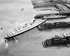 In this photo, we see the RMS Queen Elizabeth docking in New York Harbor in 1956. The Queen Elizabeth was an luxury ocean liner operated by the Cunard Line. Her career ran from her launch on September 27, 1938 until her retirement in 1969, when she was replaced by the Queen Elizabeth II.