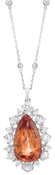 White Gold, Imperial Topaz and Diamond Pendant with White Gold and Diamond Chain  14 kt., the pendant centering one pear-shaped Imperial topaz of brownish reddish orange hue, approximately 19.76 cts., surrounded by alternating 8 round and 8 pear-shaped diamonds approximately 3.35 cts., completed by a diamond chain accented by 14 collet-set round diamonds. Length 18 inches.