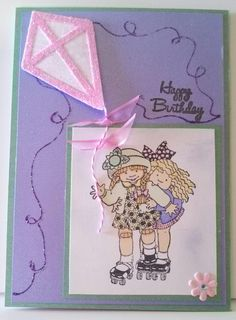 "A beautiful Spring day to fly a kite :)  The stamp is one of ""Janie's Grilfriends"".  The kite is from a Sizzix stamp and emboss die set."