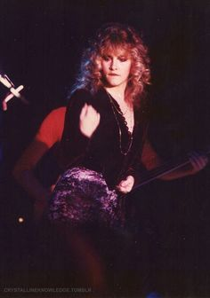 Stevie onstage wearing a crushed velvet mini skirt ~  and she's biting her lower lip, a cute decades-long habit of hers      ~ ☆♥❤♥☆ ~    here she performed her iconic song 'Gold Dust Woman' at a live concert: Bob Welch and Friends: Live from the Roxy, in 1981 ~  https://en.wikipedia.org/wiki/Live_from_the_Roxy