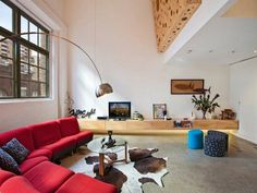 Raw wood console, huge plywood art piece on the wall.  Massive curved red couch.  It's like they know me or something.