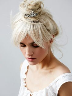 Dress up your messy top knot with a cool hair accesory