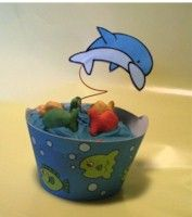 Dolphin Cupcake Decoration is the perfect holder for your ocean themed party. Free instructions and pattern at www.freekidscrafts.com