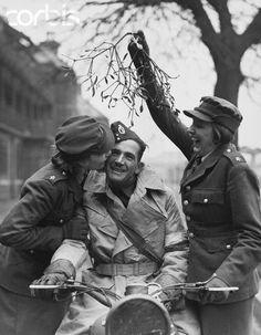ATS Girl Kisses Soldier Under Mistletoe - HU036021 - Rights Managed - Stock Photo - Corbis