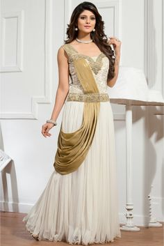 White Colour Net Fabric Designer Semi Stitched Gown Comes With Matching Dupatta. This Gown Is Crafted With Resham Work,Embroidery,Cut Dana,Stone Work,Diamond Work. This Gown Comes as Semi Stitched So ...