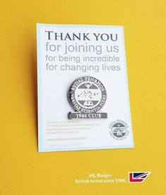 Nice badge with informative backing card.