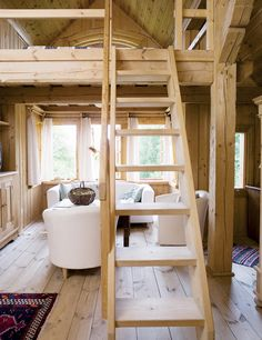 This tiny house with loft. Unfinished light wood everywhere. Light and airy. The white furniture would never do, though.