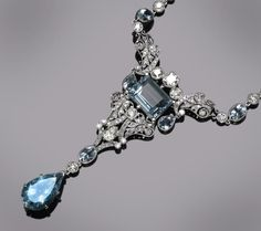 An aquamarine and diamond necklace  estimated total aquamarine weight: 10.45 carats; estimated total diamond weight: 3.05 carats; mounted in eighteen karat white gold; length: 16in.
