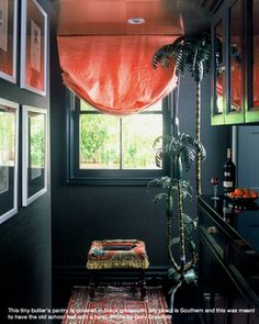 Black grasscloth on walls and black glossy ceiling let shade pop