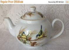 Baum Bros Formalities tea pot with birds on a tree branch with acorns on a white background. This lovely #teapot has gold gilt trim and lovely muted colors.   Use this teapo... #vintage #etsy #gifts #servingware #dinnerware