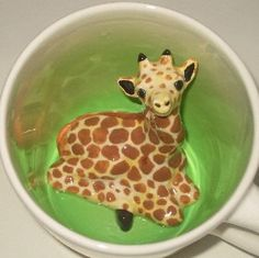 WHO IS HIDING IN MY CUP?  This Giraffe Mug is part of the ANIMUGS (TM) collection, made entirely in our Cambridge, Massachusetts studio.  It is