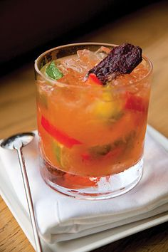 The Barbacoa, w mezcal, lemon juice, agave nectar, ginger syrup, pureed chipotle, lime, strip red bell pepper, beef jerky for garnish