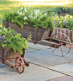 "Large Solid Wood Wheelbarrow Planter with Functional Wheel. Inspired by 18th-century wheelbarrows, these garden wagons look great by your porch or in your garden. Fill them with items appropriate for each season – pumpkins or mums in the fall, tulips in the spring, bright geraniums in summer. Constructed of solid wood with steel legs and a functional wheel. Easy assembly.   Small 30-1/4""L x 13-1/2""W x 11""H  Large 43-1/4""L x 15""W x 15-1/4""H"