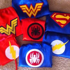 My DIY superhero capes....$2 capes from haloheaven.com, felt and wonder under.