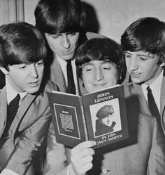 "The Beatles reading John's book ""A Spaniard in the Works"", first published June 24, 1965"