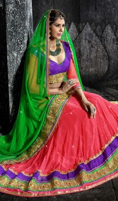 Stand a class apart from the regular crowd dressed in this salmon shade embroidered net choli skirt. The wonderful attire creates a dramatic canvas with wonderful lace, resham and stones work. Upon request we can make round front/back neck and short 6 inches sleeves regular choli blouse also. #NewLatestDesignOfNetCholi