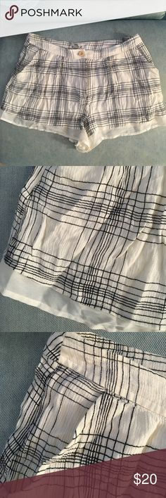 UO plaid shorts Off-white and black plaid flowy shorts with chiffon trim. Waist isn't adjustable but fits a 4-6. Brand is COPE but purchased at urban outfitters. Urban Outfitters Shorts