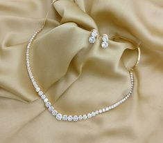 American Diamond Sepal One Line Necklace Set. Rama Creations Manufacturer & Who… American Diamond Sepal One Line Necklace Set. Rama Creations Manufacturer & Wholesaler of Imitation Bridal Jewelery in India. Gold Earrings Designs, Gold Jewellery Design, Necklace Designs, Gold Jewelry, Diamond Jewelry, Jewelry Box, Jewelry Making, Jewelry Findings, Jewelry Ideas