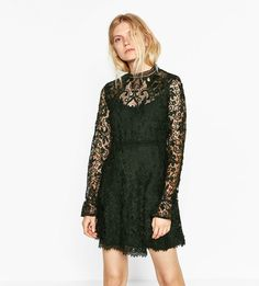 "A gorgeous minidress with a high collar and bell sleeves in evergreen lace. | 39 Dresses That Scream ""Holiday Party"""