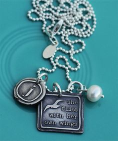 she flies with her own wings. I have always wanted a piece of jewelery with this quote and then I found THIS. LOOOVE.