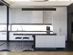 Power Street by Steve Domoney Architecture - white kitchen with stone surface