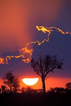 Sunset at Kruger National Park, South Africa. It's a beautiful effect when the sun outlines the clouds. This back lit sunset image is particularly lovely. All Nature, Amazing Nature, Amazing Sunsets, Beautiful Sunset, Beautiful World, Beautiful Scenery, Simply Beautiful, Absolutely Gorgeous, Beautiful Things
