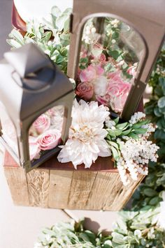 Lanterns can be the perfect table centerpiece for a rustic summer wedding. Try complimenting them with tea lights, wooden blocks, or small branches.