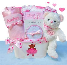 Super sweet! This deluxe baby girl gift basket features an adorable first teddy bear and super soft satin lined baby blanket. The new mom will cherish this keepsake handprint tin which will help remin
