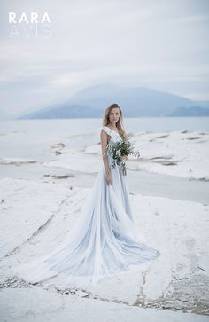 Bohemian light blue and lace wedding dress 'Delon' with open back and lace top. Wedding Bloom Collection from Rara Avis designer.