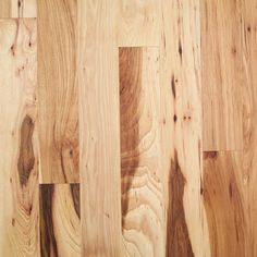 """This is natural hickory in a 2nd grade. Hickory is graded differently than oak with 1st grade being the highest, then 2nd then 3rd grade.  This product has a lot of rustic variation in 2nd and 3rd grade as you can see.  However when stained the product retains that natural wood look but becomes more consistent in its color tone.  To see this product stained look at the pin on this board entitled """"Random width handscraped hickory"""" and you'll see the transformation. Hickory Wood Floors, Maple Hardwood Floors, Wooden Flooring, Kitchen Cabinets And Flooring, Barbie Dream House, Natural Wood, Home Remodeling, Rustic, Boards"""