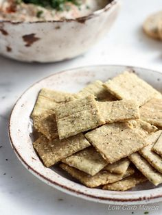 Low carb Crispy Almond Sesame Crackers. Eat on their own as a snack or serve as an appetizer with cheese or low carb dips! These crackers are low carb, dairy-free, gluten-free, paleo, keto and THM compliant.