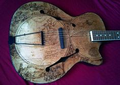 """Le Monde.""""Refurbished Polish 'Devil Jazz' guitar with hand burned '18th century world map'made by:ArtisticVisionsPyrography"""" - @artisticvisionspirography"""