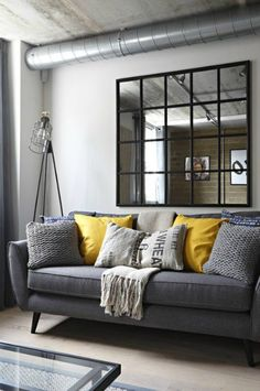 A gray industrial living room with a gray sofa and yellow pillows as a pop color. : A gray industrial living room with a gray sofa and yellow pillows as a pop color and a black mirror hanging over the sofa. Living Room Themes, Living Room Colors, New Living Room, Living Room Paint, Living Room Sofa, Apartment Living, Mustard Living Rooms, Grey And Yellow Living Room, Grey Bedroom With Pop Of Color