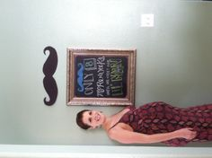 My Niece and her homemade chalkboard that she wrote a message on before her Baby Shower...  keeping with the theme!