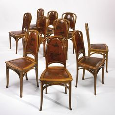 Louis Majorelle SET OF TEN SIDE CHAIRS walnut and original leather upholstery with dyed foliate decoration - 1900