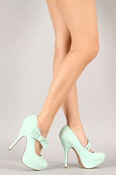 #urbanog Let's go dancing....or bridesmaid shoes. Fall in love with this beautiful platform pump! Featuring smooth faux suede upper, almond toe, double Mary Jane strap with bow accent, tribute platform, and stiletto heel. Finished with lightly padded insole for comfort.