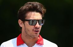Jules Bianchi Photos Photos - Jules Bianchi of France and Marussia walks in the paddock before the Chinese Formula One Grand Prix at the Shanghai International Circuit on April 14, 2013 in Shanghai, China. - F1 Grand Prix of China